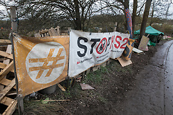 Harefield, UK. 13 January, 2020. Banners at the Colne Valley protection camp, part of which was evicted by bailiffs last week. 108 ancient woodlands are set to be destroyed by HS2 and further destruction of trees in the Harvil Road area for the high-speed rail link is believed to be imminent.