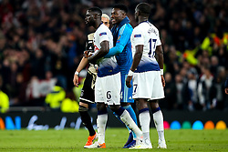 Davinson Sanchez of Tottenham Hotspur cuts a frustrated figure as he is hugged by Andre Onana of Ajax - Mandatory by-line: Robbie Stephenson/JMP - 30/04/2019 - FOOTBALL - Tottenham Hotspur Stadium - London, England - Tottenham Hotspur v Ajax - UEFA Champions League Semi-Final 1st Leg