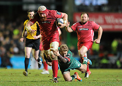 Scarlets lock, Jake Ball is tackled by Leicester Tigers full back, Mathew Tait - Photo mandatory by-line: Dougie Allward/JMP - Mobile: 07966 386802 - 16/01/2015 - SPORT - Rugby - Leicester - Welford Road - Leicester Tigers v Scarlets - European Rugby Champions Cup