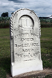 17 July 2009:  Hittle Grove cemetery, historical burial site of the Orndorff - Albright massacre of 1860, is located in Tazwell County Illinois. Grave and of Stephan Peine..  ..About the massacre:..On the morning of the 12th of Oct. A.D. 1860, the husband and father in whose memory this monument is erected, was called away on business, from his residence three miles southeast of Delavan, Illinois. He left his family, consisting of his wife and two small daughters.  When he returned, no little ones ran to greet him, as was their custom. This caused alarm for the welfare of his dear ones.  Entering the house, he found his wife and daughters, whom he had left in perfect health and joyful spirits a few hours earlier.  They had been  murdered while he was absent. They were now lying prostrate and weltering in their blood.  The mother and younger daughter were already dead.  The older daughter was still living and moaning piteously but unable to whisper one word to her father.  At four o'clock the next morning, death ended her suffering.  Kind friends carried them in one coffin, to their last resting place...The murderer was a former hired hand. As he was robbing the family. He killed them in order to cover up the crime.  He was later found hiding in a corn crib in Logan County and was returned to Pekin where he became the first man to be hung in Tazewell County.  .