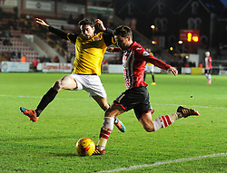 Exeter City's Arron Davies crosses the ball. - Photo mandatory by-line: Alex James/JMP - Mobile: 07966 386802 - 10/01/2015 - SPORT - football - Exeter - St James Park - Exeter City v Northampton - Sky Bet League Two