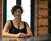 Tamra Asmuth, dispensing optician at One Hip Chic on Park Avenue in Rochester on Tuesday, June 30, 2015.