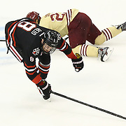 Adam Reid #8 of the Northeastern Huskies on the ice during The Beanpot Championship Game at TD Garden on February 10, 2014 in Boston, Massachusetts. (Photo by Elan Kawesch)