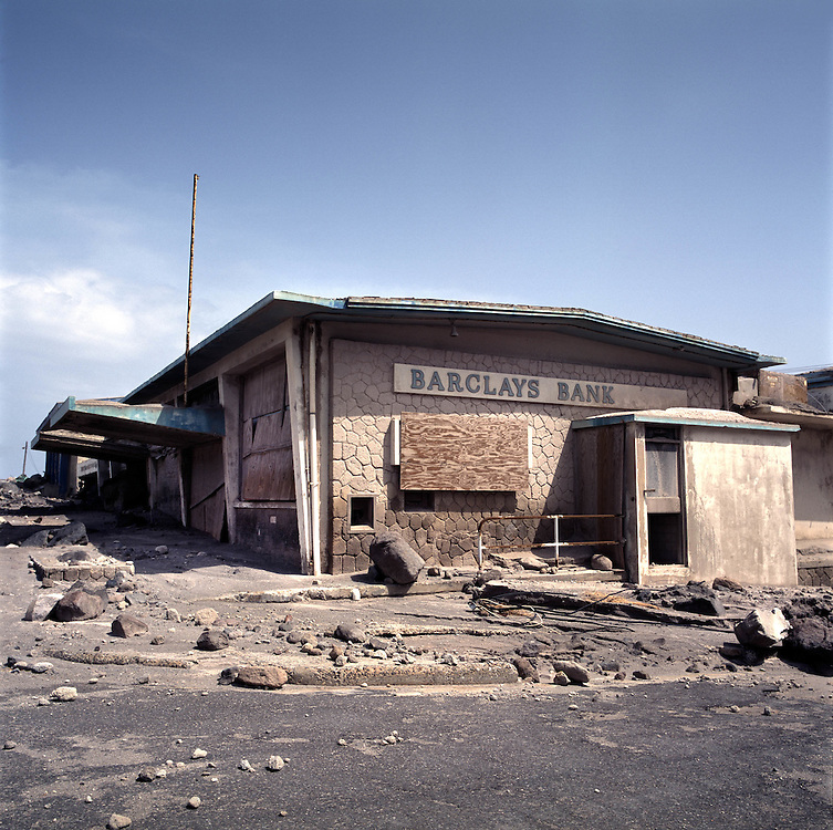 The former capital of Montserrat, Plymouth, which is now covered under a layer of ash, mud and rock from the eruption of the Soufriere Hills volcano over the last 10 years. The area is out of bounds to everyone except scientists. Photo shows destroyed Barclays Bank..