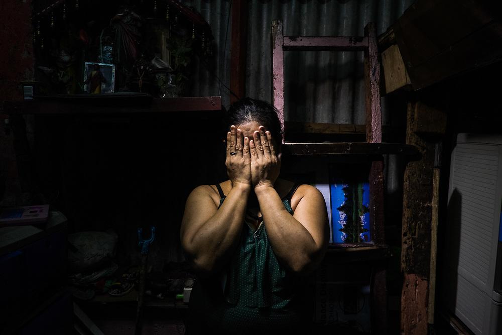 A widow of an extrajudicial execution.