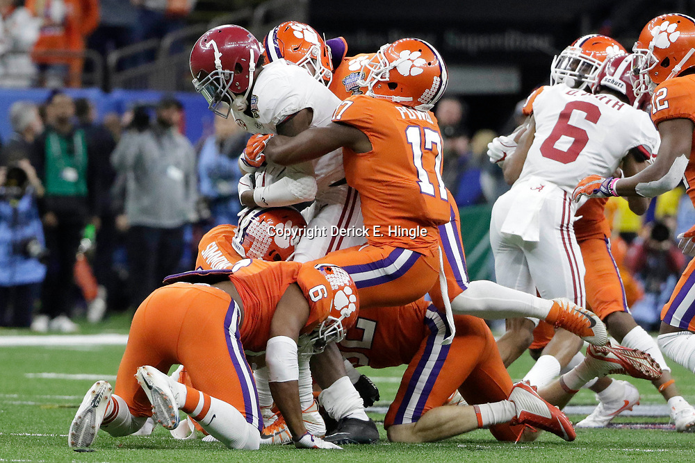 Jan 1, 2018; New Orleans, LA, USA; Alabama Crimson Tide defensive back Trevon Diggs (7) is brought down by Clemson Tigers wide receiver Cornell Powell (17) during the second quarter in the 2018 Sugar Bowl college football playoff semifinal game at Mercedes-Benz Superdome. Mandatory Credit: Derick E. Hingle-USA TODAY Sports
