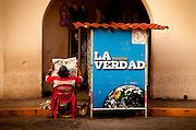 Selling newspapers in Merida
