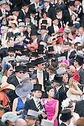 © Licensed to London News Pictures. 07/06/2014. Epsom, UK Derby Day today 7th June 2014 at Epsom 2014 Investic Derby Festival in Surrey. Traditionally, elegant, fashionable racegoers gather for a classic day's racing at Epsom Racecourse, Surrey. Photo credit : Stephen Simpson/LNP