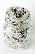 glass jar stuffed with newspaper