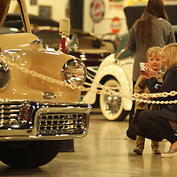 Wyatt Burleson, 3, and his grandmother Lynn McCharen, get a photo of the Tucker 48 as they visit the Tupelo Automobile Museum on his final day open to the public Sunday afternoon.