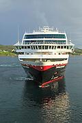 Hurtigruten ship 'Trollfjord' arriving at port of Rorvik, Norway