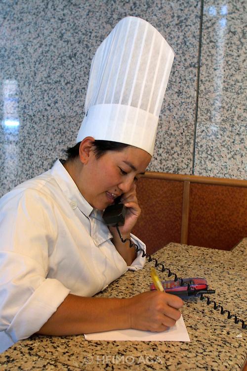 ULAN BATOR, MONGOLIA..08/21/2001.Chinggis Khaan Hotel. Female chef..(Photo by Heimo Aga)