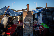 """Shadows of visitors and activists at the barricades blockading a building supplies store named """"Epicenter"""" in the city of Lviv, Ukraine."""