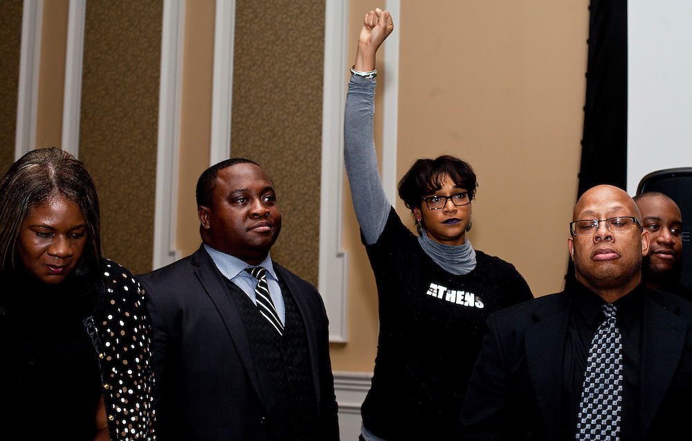 Ohio University staff and staff faculty including Allison Hunter, Editor-In-Chief of WOUB News, center, reacts to President Roderick J. McDavis's speech encouraging students to seek them out for guidance at the All Black Affair at Baker University Center Ballroom at Ohio University on Friday, January 29, 2016. © Ohio University / Photo by Sonja Y. Foster