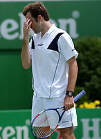 MELBOURNE, AUSTRALIA - JANUARY 20: Greg Rusedski of Great Britain stands dejected during his match against Albert Costa during day two of the Australian Open. 20/01/2004, in Melbourne, Australia. (Photo by Lars Mueller/Sportsbeat) *** Local Caption *** Greg Rusedski