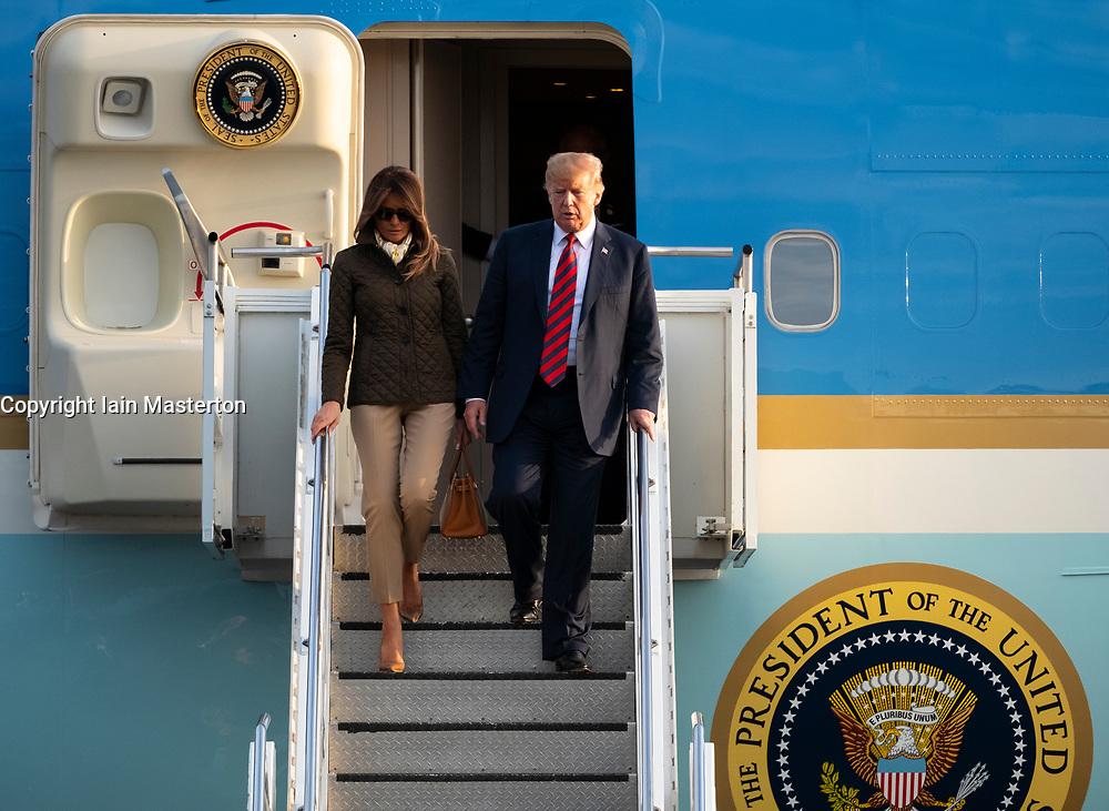 Prestwick Airport, Scotland, UK. 13 July, 2018. President Donald Trump arrives on Air Force One at Prestwick Airport in Ayrshire ahead of a weekend at his golf resort at Trump Turnberry. President Trump and Melania exit aircraft.