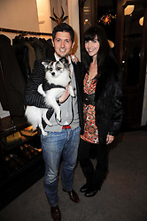 WILL HAMBLING hold his dog Stella and DUNJA KNEZEVIC at a party to celebrate the publication of Dogs in Vogue by Judith Watt held at James Purdey & Sons, Audley House, 57-58 South Audley Street, London W1 on 3rd December 2009.