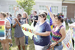 The Rowan County Rights Coalition held a rally outside the Rowan County Courthouse in protest of Kim Davis' boycott on issuing marriage licenses, Saturday, Aug. 29, 2015 in Morehead.