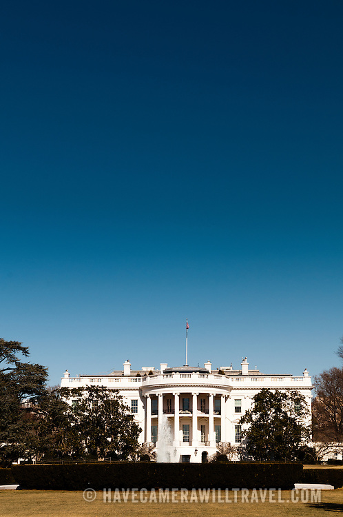 The White House with clear blue sky and portrait orientation. The home and office of the President of the United States, the White House is at 1600 Pennsylvania Ave NW, Washington DC.