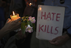 August 13, 2017 - Washington, DC, U.S - ''Charlottesville Solidarity Action'' holds a candlelight vigil in front of the White House in Washington, D.C. on August 14, 2017, quietly singing during the peaceful rally.  Protests took place in many states following the violence and tragedy in Charlottesville VA on Saturday during a White Supremacist ''Unite the Right'' rally resulting in deaths and injuries. (Credit Image: © Carol Guzy via ZUMA Wire)