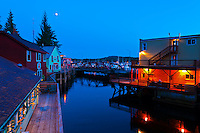 Creek Street historic district at twilight (with Ketchikan Creek flowing through it), Ketchikan, Southeast Alaska USA