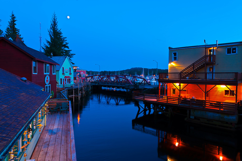 Creek Street historic district at twilight (with Ketchikan Creek flowing through it), Ketchikan, Southeast Alaska USA