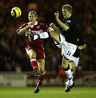 The FA Barclays Premiership<br />1 January 2005, The Riverside, Stadium, Middlesbrough<br />Newcastle United v Arsenal<br />Middlesbrough v Manchester United<br />Manchester United's Darren Fletcher beats Middlesbrough's Ray Parlour to the ball<br />Pic Jason Cairnduff/Back Page Images