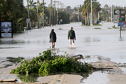 September 11, 2017 - Everglades City, Florida, U.S. - Everglades City residents MARLENE SASSAMAN, , 68, left, and RON OUELLETTE , 68, are stunned by flood water on Collier Avenue on Monday in downtown Everglades City moments after returning to their city, which became inundated with water in the aftermath of Hurricane Irma's landfall on Sunday. (Credit Image: © Douglas R. Clifford/Tampa Bay Times via ZUMA Wire)