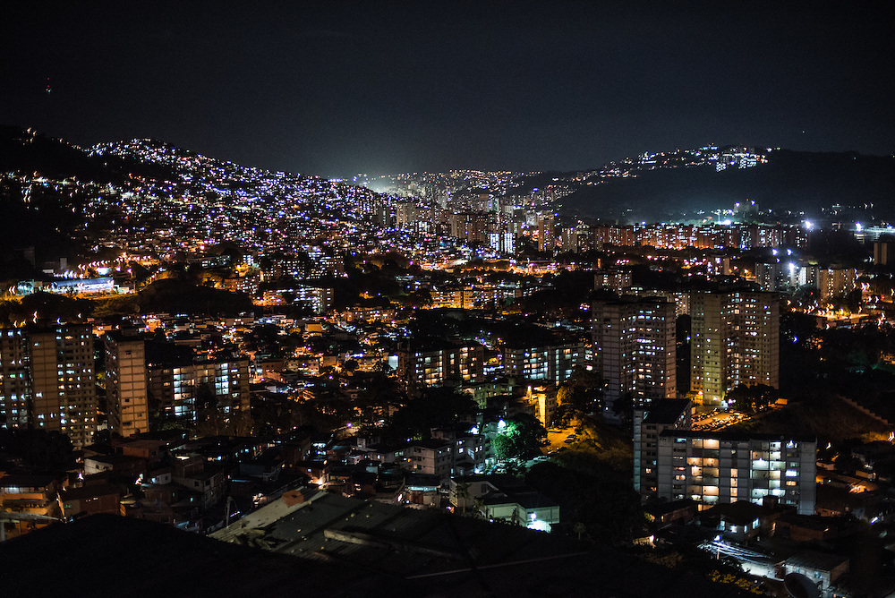 CARACAS, VENEZUELA - NOVEMBER 5, 2016: The view of Caracas from a slum in Coche. A severe economic crisis in Venezuela, caused by the drop in oil prices and years of economic mismanagement under a Socialist government, has lead to an alarming rise in crime and insecurity in the country.  Hyperinflation has left both the working class and professional class of workers with salaries that cannot purchase enough food to feed their families. Many people are turning to crime to make ends meet.  PHOTO: Meridith Kohut for The New York Times