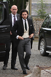 RETRANSMITTED WITH CORRECTED CAPTION Groom Game of Thrones star Kit Harington, who plays Jon Snow, arriving at Rayne Church in the village of Kirkton of Rayne, Aberdeenshire, for his wedding ceremony with his co-star Rose Leslie, who played Ygritte in the drama.