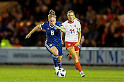 Kim Little (#8) of Scotland dribbles the ball forward pursued by Lara Dickenmann (#11) of Switzerland during the 2019 FIFA Women's World Cup UEFA Qualifier match between Scotland Women and Switzerland at the Simple Digital Arena, St Mirren, Scotland on 30 August 2018.