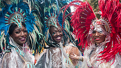 © Licensed to London News Pictures. 31/08/2015. London, UK. Dancers brave the heavy rain to take part in Notting Hill Carnival, Europe's biggest Caribbean festival. Photo credit : Stephen Chung/LNP
