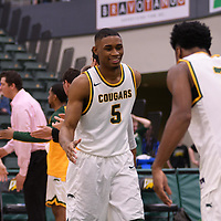 4th year guard Brandon Tull (5) of the Regina Cougars makes his entrance during the home opener  on November  4 at Centre for Kinesiology, Health and Sport. Credit: /Arthur Images