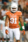 AUSTIN, TX - AUGUST 30:  Bryce Cottrell #91 of the Texas Longhorns looks on against the North Texas Mean Green on August 30, 2014 at Darrell K Royal-Texas Memorial Stadium in Austin, Texas.  (Photo by Cooper Neill/Getty Images) *** Local Caption *** Bryce Cottrell