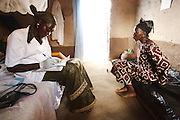 Awa Diarra, 26, 3 mo. pregnant, meets with nurse Maba N'Djim during a prenatal consultation in the village of Banankoro, Mali on Saturday August 28, 2010..