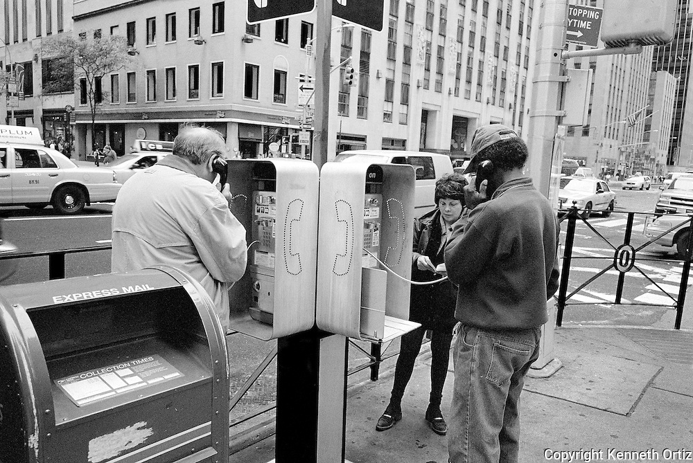 This is back in the day when street phones were still used.  These pay phones are becoming Anachronisms.