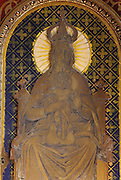 Virgin and child enthroned, detail from the High Altar, made 1610 in Italian Renaissance style, donated by Marie de Medici, wife of Henri IV, on the birth of Louis XIII, in the Basilica of Liesse Notre Dame, built 1134 in Flamboyant Gothic style by the Chevaliers d'Eppes, then rebuilt in 1384 and enlarged in 1480 and again in the 19th century, Liesse-Notre-Dame, Laon, Picardy, France. Pilgrims flock here to worship the Black Virgin, based on Ismeria, the Soudanese daughter of the sultan of Cairo El-Afdhal, who saved the lives of French knights during the Crusades, converted to christianity and married Robert d'Eppes, son of Guillaume II of France. Picture by Manuel Cohen