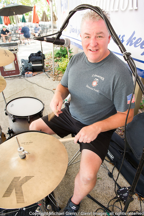 19 Sep 2015 Staten Island, New York US // John Rogers NYPD (Ret) from the group, 90's Alt Rock gets his drum set ready fot the 8th annual Lt. John Martinson Memorial Picnic at the Hillside Swim Club //  Michael Glenn  /   for the FDNY