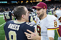 NEW ORLEANS, LA - NOVEMBER 19:  Drew Brees #9 of the New Orleans Saints talks after the game with Kirk Cousins #8 of the Washington Redskins at Mercedes-Benz Superdome on November 19, 2017 in New Orleans, Louisiana.  Saints defeated the Redskins 34-31.  (Photo by Wesley Hitt/Getty Images) *** Local Caption *** Drew Brees; Kirk Cousins