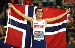 Norway's Jakob Ingebrigtsen celebrates after winning gold during the Men's 3000m final during day two of the European Indoor Athletics Championships at the Emirates Arena, Glasgow.