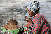 Myanmar. Woman enjoying a cheroot at Aungban Market. Shan State.