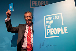 "© Licensed to London News Pictures. 22/11/2019. London, UK. Nigel Farage holds up a copy of ""Contract With The People"" as he outlines the policies of The Brexit Party at a press event in Westminster. The Brexit Party is contesting a number of seats in the forthcoming general election. Photo credit: Rob Pinney/LNP"