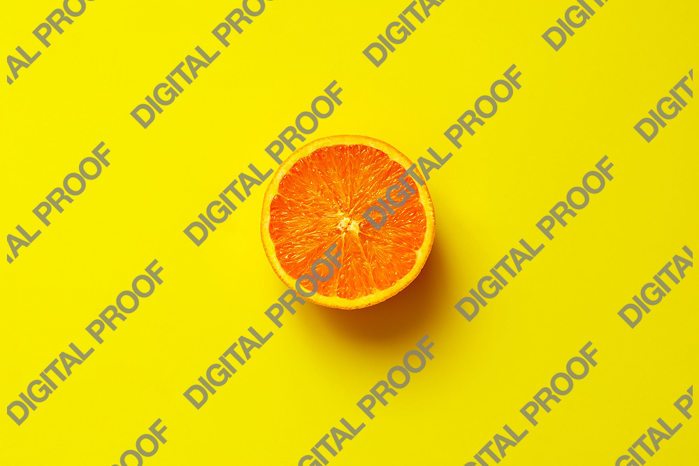 Orange fruit. Orange half fruit sliced isolate on yellow background seen from above flatlay style, close up.