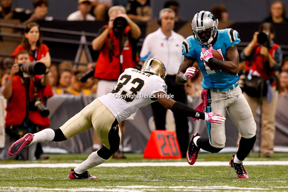 October 3, 2010; New Orleans, LA, USA; Carolina Panthers wide receiver Brandon LaFell (11) escapes from New Orleans Saints cornerback Jabari Greer (33) during the second half at the Louisiana Superdome. The Saints defeated the Panthers 16-14. Mandatory Credit: Derick E. Hingle