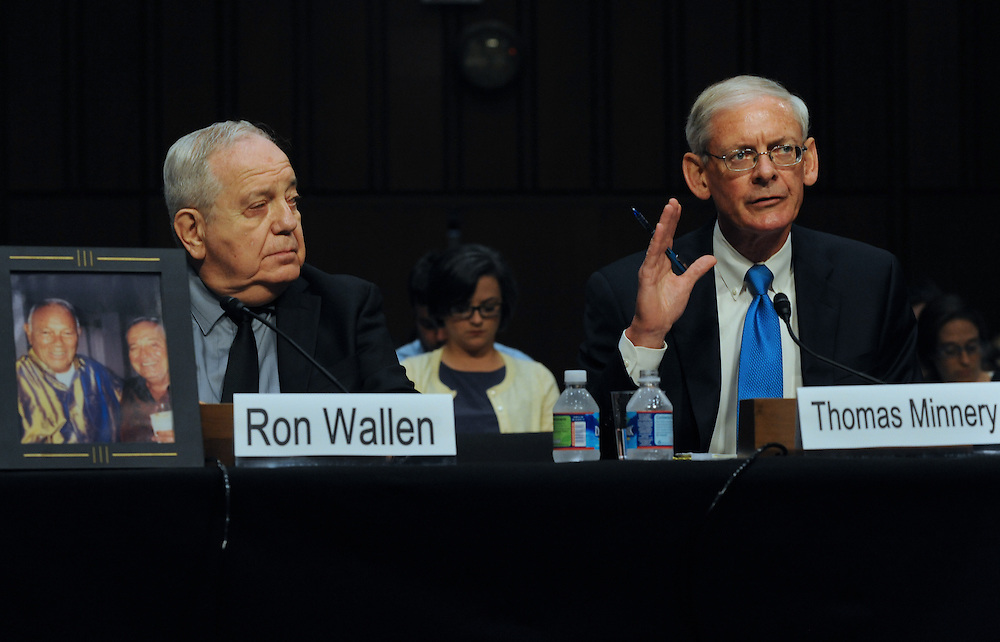 """Ron Wallen listens to Thomas Minnery's testimony during a hearing entitled """"S.598, The Respect for Marriage Act: Assessing the Impact of DOMA on American Families."""" Minnery is the senior vice president for public policy for Focus on Family. Wallen, who lost his partner to leukemia, has been denied marital benefits under DOMA."""