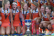 The Netherlands team smile and joke with the trophy during the Vitality Hockey Women's World Cup 2018 Finals Gold Medal match between the Netherlands and Ireland, at the Lee Valley Hockey and Tennis Centre, QE Olympic Park, United Kingdom on 5 August 2018. Picture by Martin Cole.