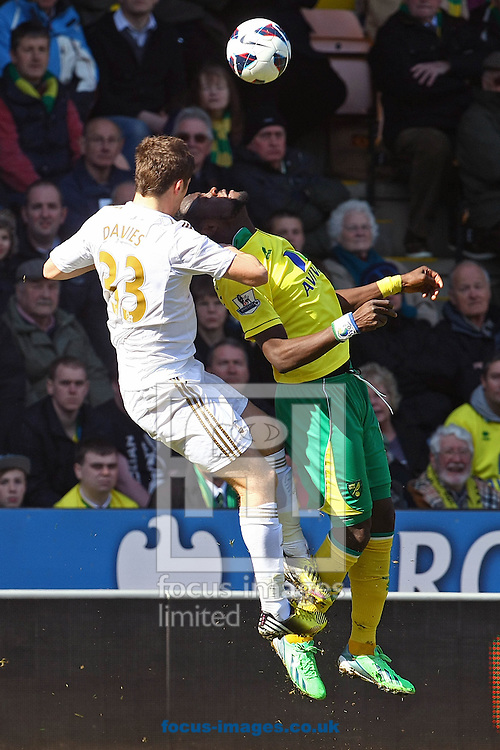Picture by Paul Chesterton/Focus Images Ltd +44 7904 640267.06/04/2013.Darnel Situ of Swansea and Kei Kamara of Norwich in action during the Barclays Premier League match at Carrow Road, Norwich.
