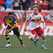 Dax McCarty, (right), New York Red Bulls, challenged by Santi Cazorla, Arsenal, in action during the New York Red Bulls Vs Arsenal FC,  friendly football match for the New York Cup at Red Bull Arena, Harrison, New Jersey. USA. 26h July 2014. Photo Tim Clayton