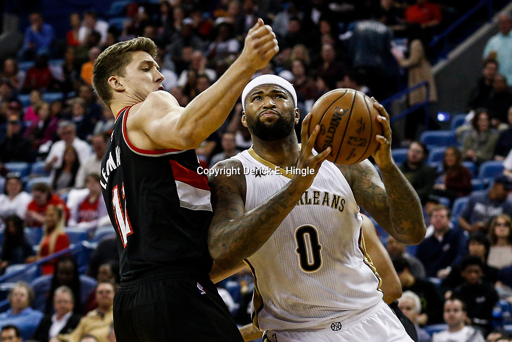 Mar 14, 2017; New Orleans, LA, USA; New Orleans Pelicans forward DeMarcus Cousins (0) drives past Portland Trail Blazers forward Meyers Leonard (11) during the second quarter of a game at the Smoothie King Center. Mandatory Credit: Derick E. Hingle-USA TODAY Sports