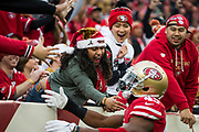 San Francisco 49ers fans celebrate with San Francisco 49ers defensive back Tyvis Powell (45) during the first quarter Jacksonville Jaguars at Levi's Stadium in Santa Clara, Calif., on December 24, 2017. (Stan Olszewski/Special to S.F. Examiner)